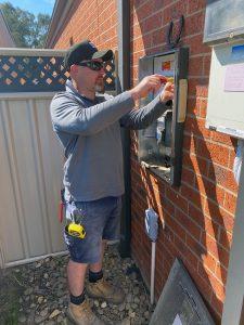 electrician installing switchboard